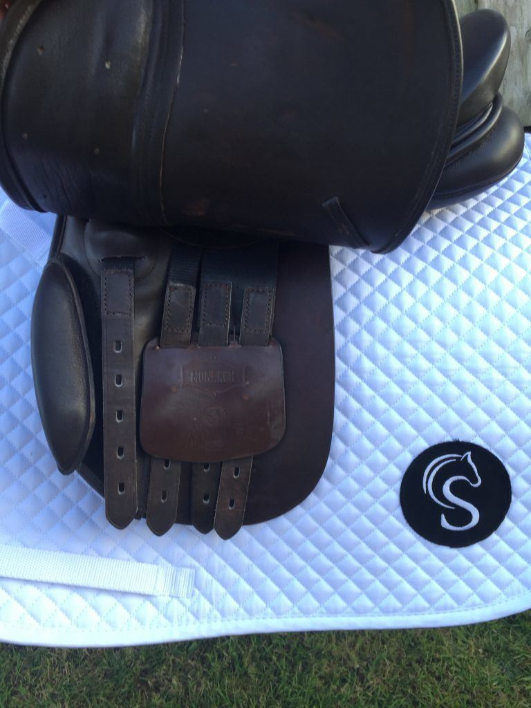 Under the saddle Flap ( a picture of each side is required)